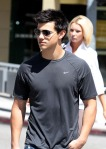 EXCLUSIVE_ Taylor Lautner wore a gray colored Nike T_shirt_blue  jeans and worn black boots after shopping at a Nike clothing store with a friend  on May 10_  2010 in Beverly Hills_ CA California.